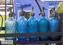 Light or dodger blue siphons on sale at the antiques market in Barrancas, Buenos Aires. - Argentina 2007