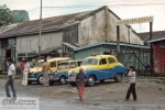 A taxi station at Taunggyi. These cars were imported from India, I believe.