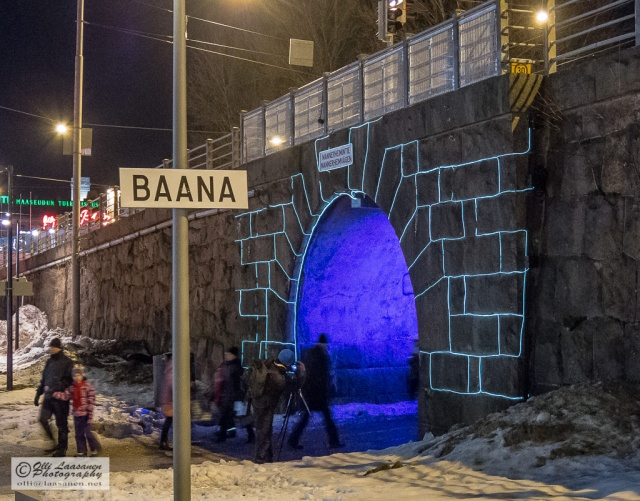 """Memory of Stone"":  a strip of light follows the shapes and forms of the granite rock at the ""gateway"" to Baana, highlighting the surfaces of the stone bridge and the granite architecture in surprising ways."