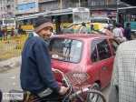 Rikshaw driver in the traffic.