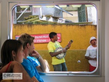 Banjo player entertaining the train passengers in Rio de Janeiro, Brazil. May 2005.