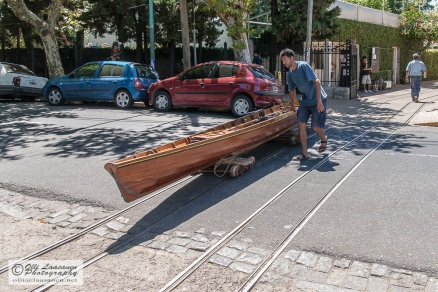 Rowing boats are carried over the street to the Parańa River via rails.