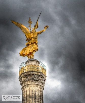 The bronze statue (designed by Friedrich Drake) on top of the column is the goddess Victoria. It is 8.3 metres high and weights 35 tonnes.