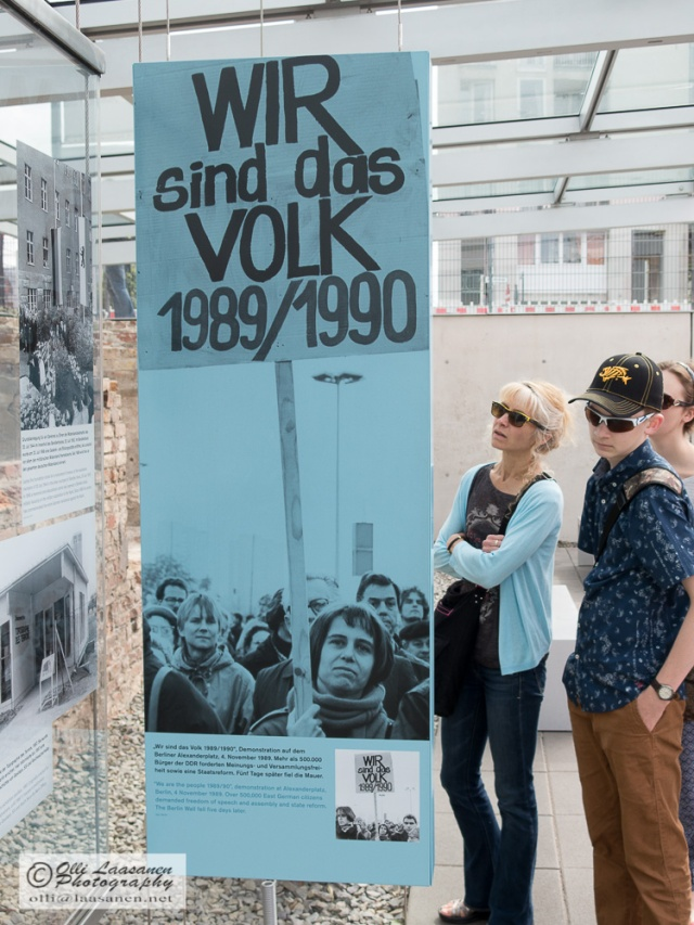 "Visitors at the exhibition ""Berlin 1933–1945. Between Propaganda and Terror""  (Niederkirchnerstrasse 8). The picture in the poster is taken four days before the opening of the wall."