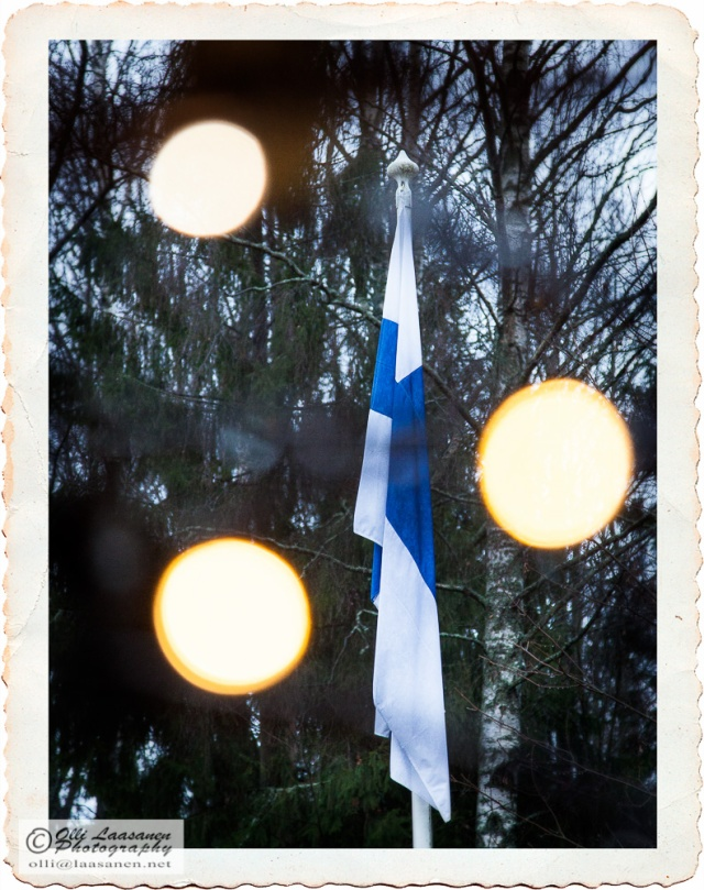 The flag of Finland during a gray, rainy and calm day of independence, 6th of December 2014