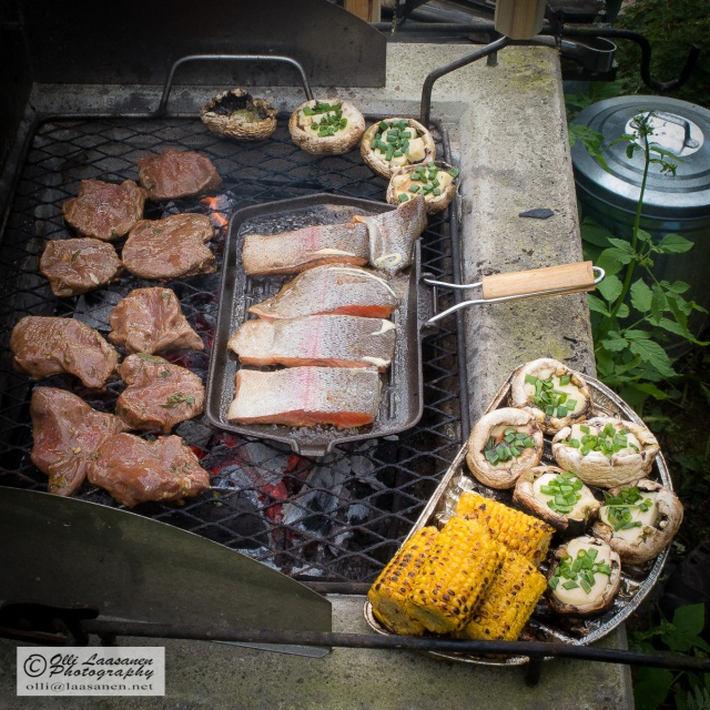 Meat, fish, corn, stuffed mushrooms (yes, the sausages are missing!) barbecued  on open fire - what else a man needs during Midsummer.