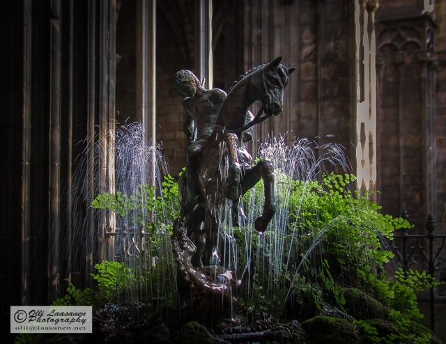 St. George in fight with the dragon. Fountain in the cloister of Barcelona Cathedral.